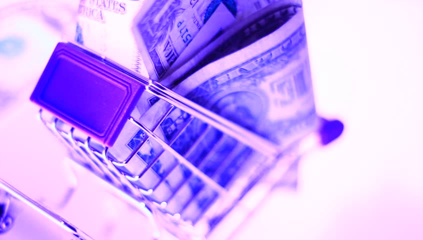 Small shopping cart with paper money. Consumption, commerce, business conceptual clip. | Shutterstock HD Video #5002802