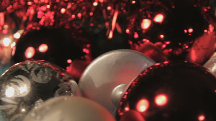 Slider Shot Of Christmas Lights, Gift Box And Baubles Laying On ...