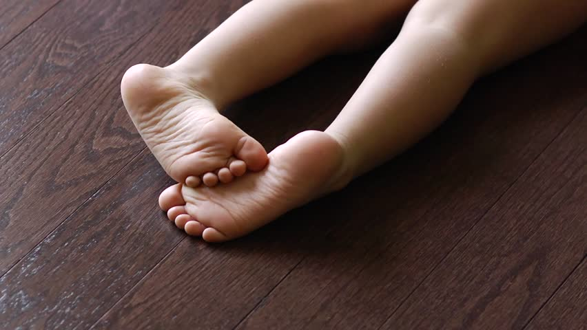 A medium shot of an infants feet as the child lounges directly on a medium shot of an infants feet as the child lounges directly on beautiful high quality hardwood floors stock footage video 5046242 shutterstock voltagebd Image collections