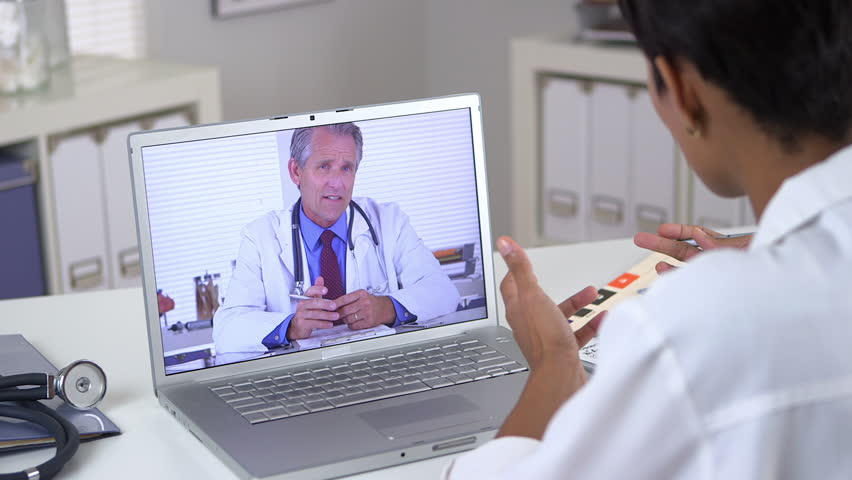 Doctor holding video conference with colleague
