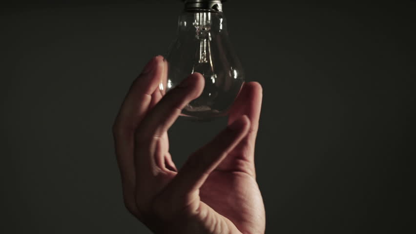 Replacing old tungsten bulb to a low consumption LED light bulb | Shutterstock HD Video #5091242