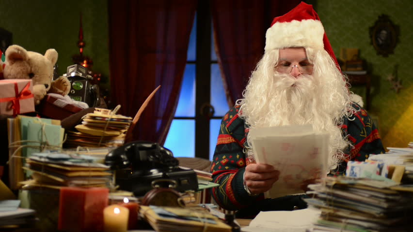 Santa Claus reading children gift letters for Christmas