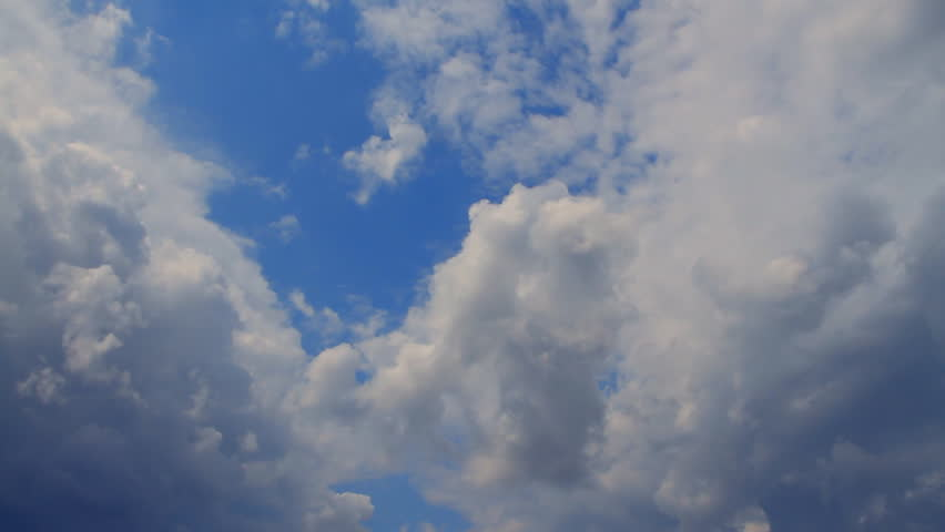 photographing the sky with cumulus clouds flying on a sunny day with strong wind