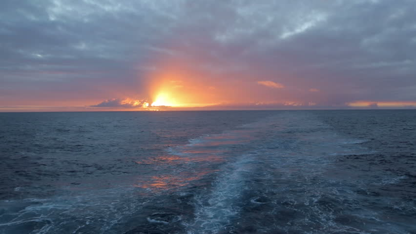 Sunrise and wake from ship at sea - HD stock video clip