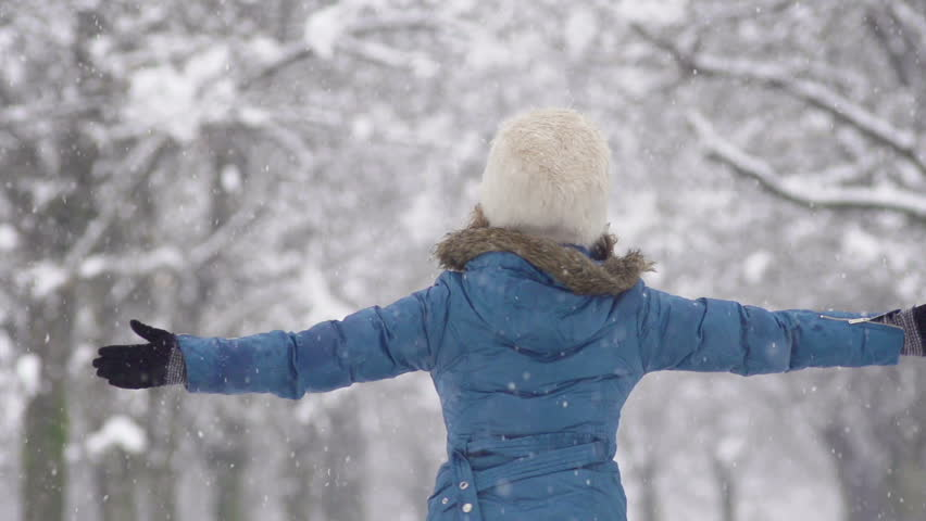 Slow Motion Of Young Woman Spinning. Her Arms Outstretched To Catch Falling