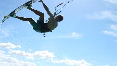 Extreme Kite Boarding Trick Over Camera In Ocean