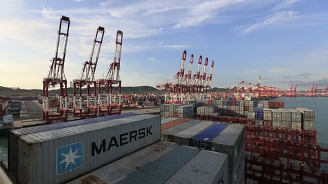 """QUINGDAO - September 18, 2013, the world's largest container ship """"mary maersk"""" maiden voyage arrived in Qingdao Port Container Terminal. """"Mary maersk"""" Denmark 18000TEU container ship."""