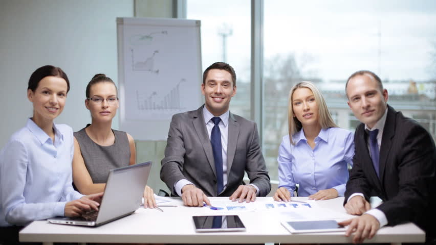 Office and teamwork concept - group of business people having a meeting and showing thumbs up | Shutterstock HD Video #5206424
