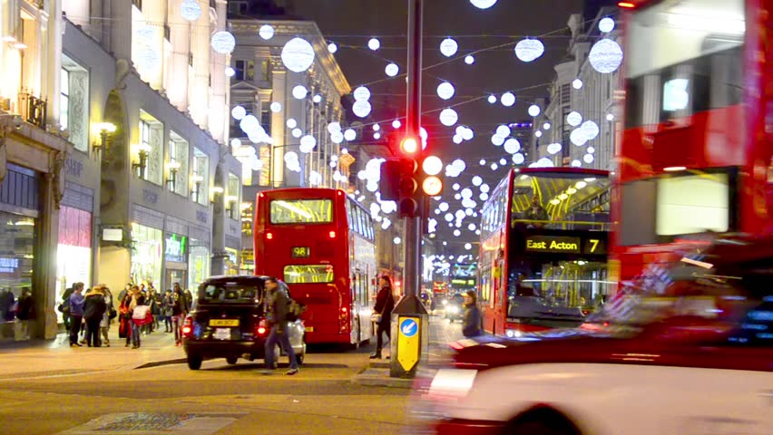 London - DEC 2013: Christmas lights and London buses at the station on busy