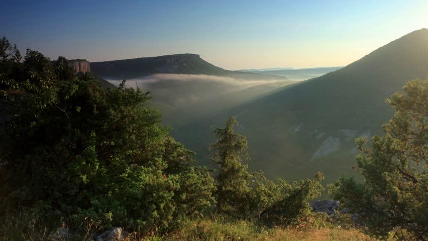 Movement of the clouds on the mountain. Cave city Tepe-Kerman, Crimea, Ukraine VI-XIV centuries  #5227622