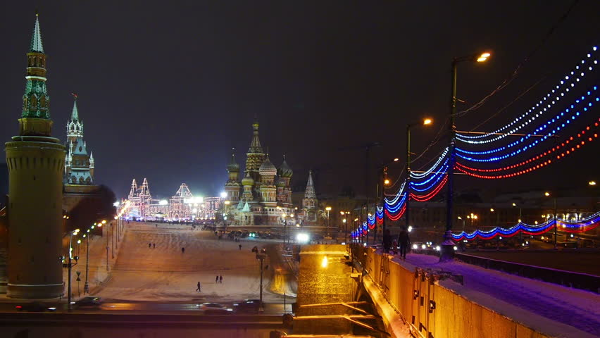 Moscow Kremlin and St. Basil's Cathedral at winter night, Christmas time. View from river side.