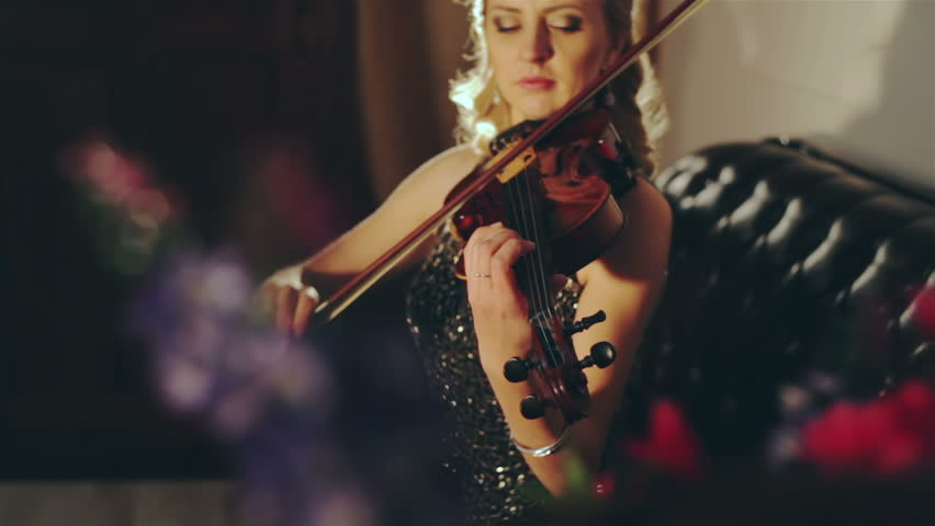 Woman in evening dress playing the violin