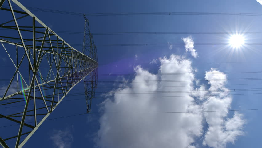 A high voltage electricity pylon time lapse with sun - dolly move. 4k Ultra high definition display! 10882   | Shutterstock HD Video #5232632