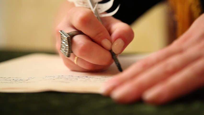 Woman writes a letter to feather 5 | Shutterstock HD Video #5247662