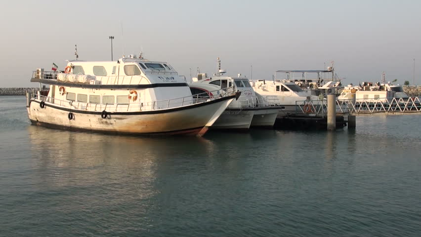 BANDAR ABBAS, IRAN - 30 OCTOBER 2013: Old ferry ships are waiting to dock in the harbor of Bandar Abbas, Iran