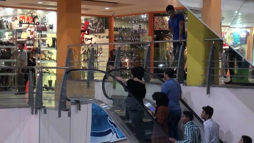 BANDAR ABBAS, IRAN - 29 OCTOBER 2013: People use an escalator to get to another floor of a large shopping mall in Bandar Abbas, Iran