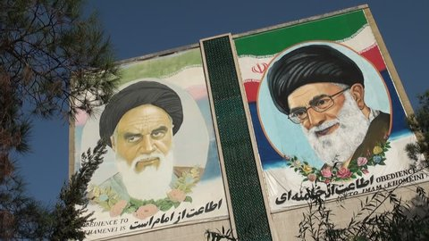 ISFAHAN, IRAN - 22 OCTOBER 2013: The former and current Supreme Leader of Iran (Khomeini and Khamenei respectively) are portrayed on a building in Isfahan, Iran