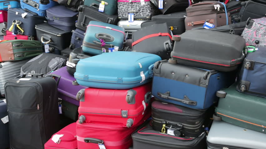 Pan of baggage on cruise ship waiting to be off loaded | Shutterstock HD Video #5277692