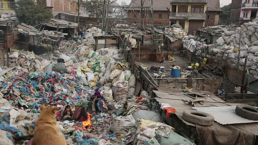 KATHMANDU, NEPAL - DEC 19: Unknown poor children makes the lessons on the dump,