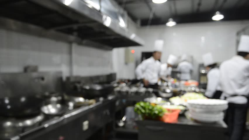 Restaurant Kitchen Video motion chefs of a restaurant kitchen stock footage video 5285252