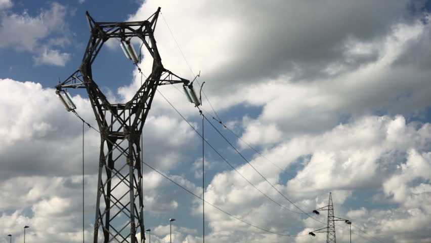Electrical tower on cloudy sky (timelapse) | Shutterstock HD Video #5289692
