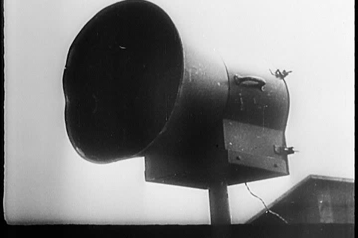 German Luftwaffe pilots rush to an air raid and man their planes.