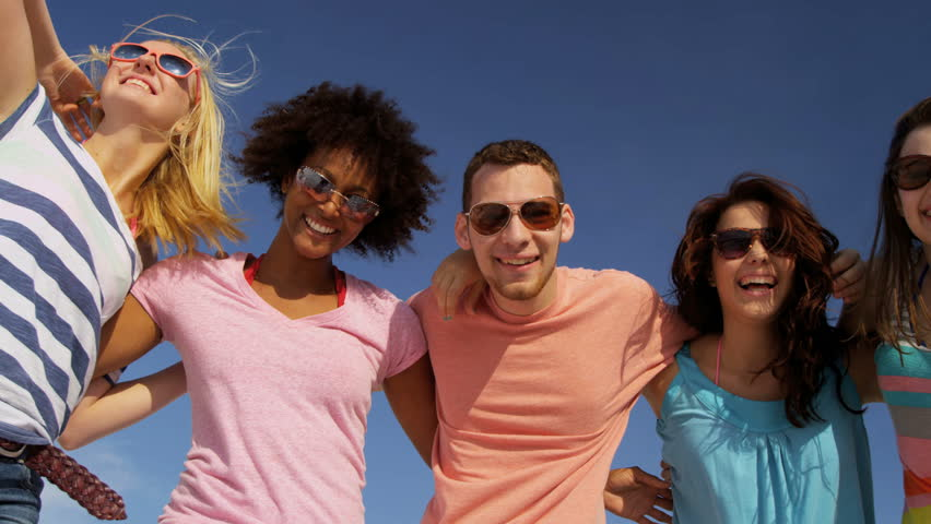 Group young multi ethnic teens casual beach clothes running smiling to camera slow motion shot on RED EPIC, 4K, UHD, Ultra HD resolution | Shutterstock HD Video #5315621