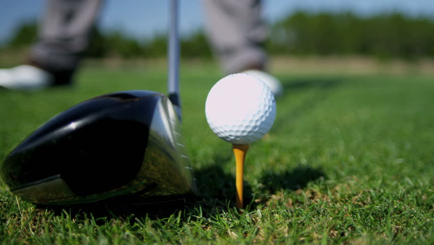 Close up ball on tee retired golfer taking swing hitting golf ball off tee on golf course feet only shot on RED EPIC, 4K, UHD, Ultra HD resolution | Shutterstock HD Video #5328854