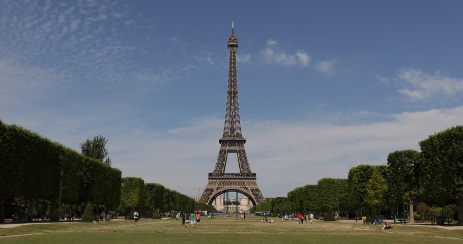 Eiffel Tower a Landmark in Paris Champ de Mars, People Commuting Passing Walking sunny day ( Ultra High Definition, Ultra HD, UHD, 4K, 2160P, 4096x2160 ) | Shutterstock HD Video #5329142