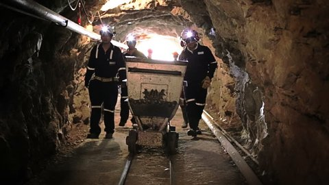Mine entrance, workers inside tunnel to start labor shift