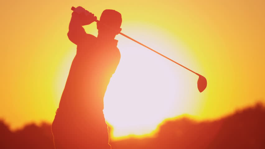 Weekend male golfer enjoying time golf course in summer driving off down fairway full setting sun background shot on RED EPIC, 4K, UHD, Ultra HD resolution | Shutterstock HD Video #5337533