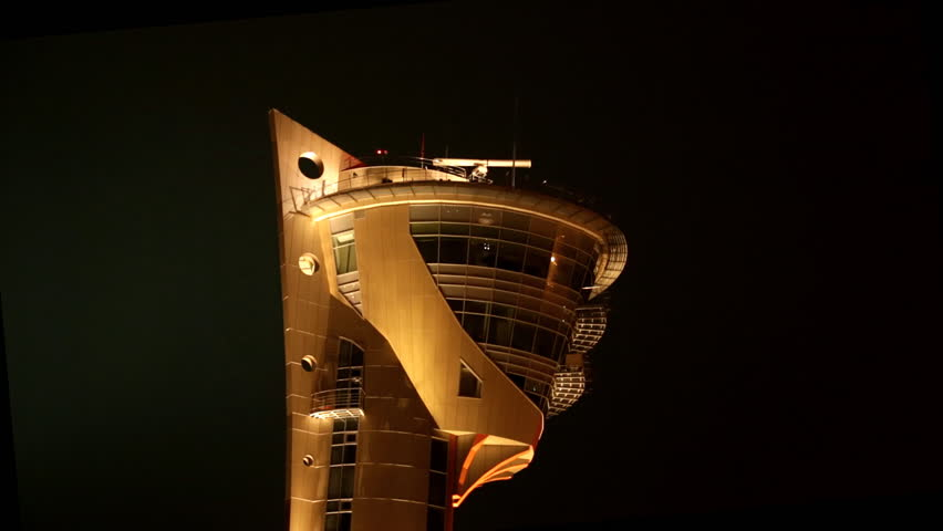 Airport tower at night with radar