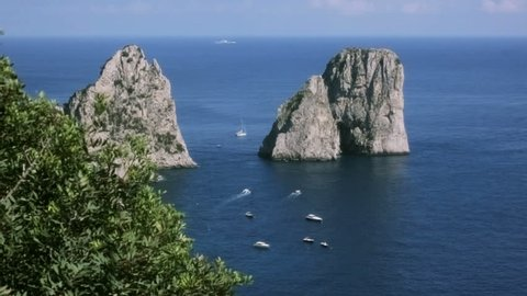 Slider shot revealing the Faraglioni of Capri. These stacks are located off the island of Capri in the Bay of Naples in Italy. The stacks have been given their own names: Stella, Mezzo  and Scopolo.