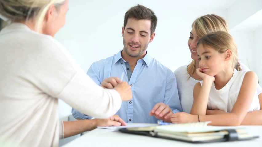 Family signing real-estate contract | Shutterstock Video #5355122