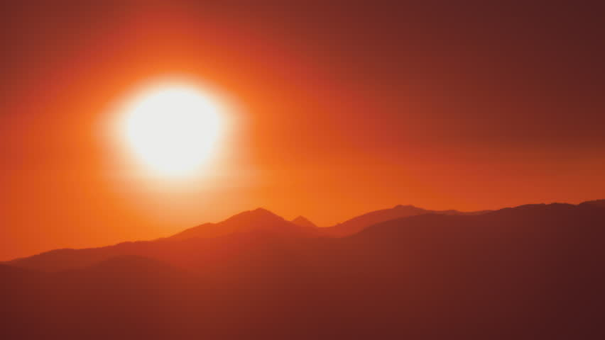 Large White Hot Sun In An Orange Glow Over Mountains #5358332
