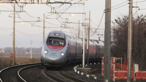 ROVIGO, ITALY - JANUARY 7, 2014: Fast Italian train connecting Rome to Venice. Public Company Ferrovie dello Stato, Train Freccia Argento