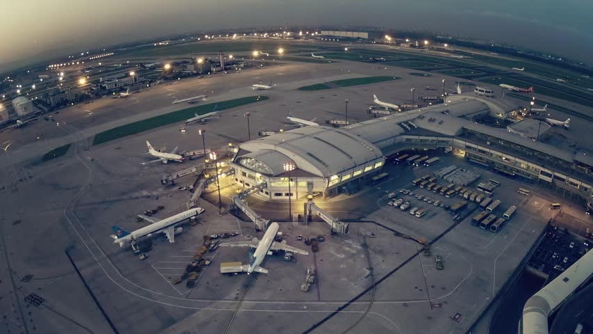 Timelapse.Aerial View.Airport Terminal at Sunset with Airplanes Taxiing and Landing. | Shutterstock Video #5392802