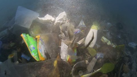 Plastic garbage and other debris underwater on a beach in Bunaken Island, Sulawesi