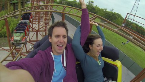 Young couple on a rollercoaster