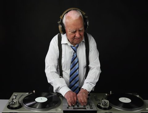 4k super high resolution version of a very funky elderly grandpa dj mixing records