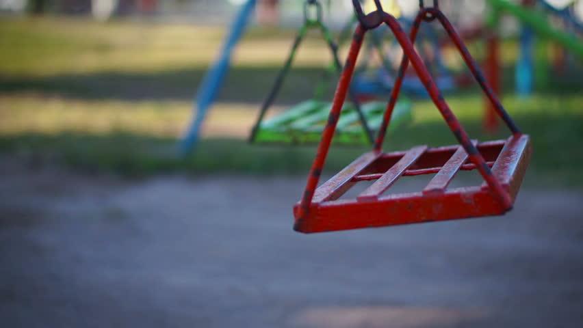 Empty swing in a children's playground