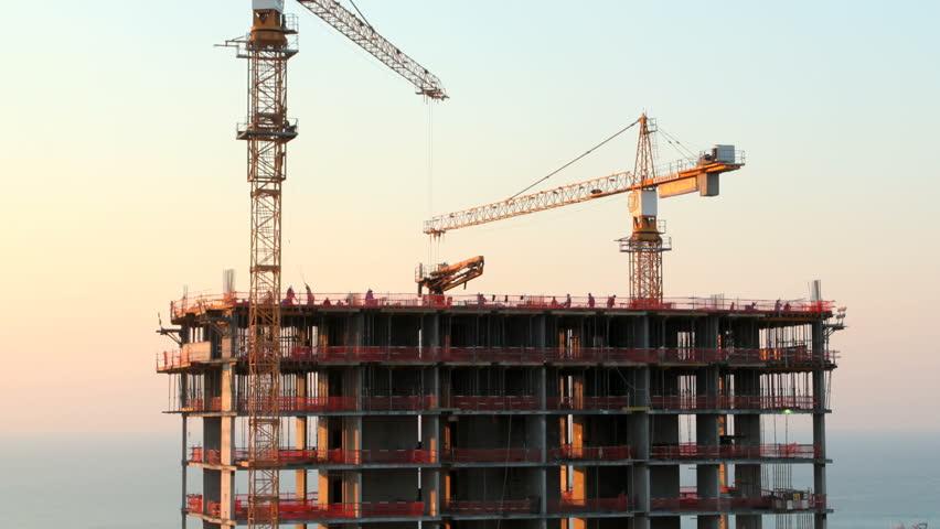 Cranes at a skyscraper construction. 1080p time lapse video.