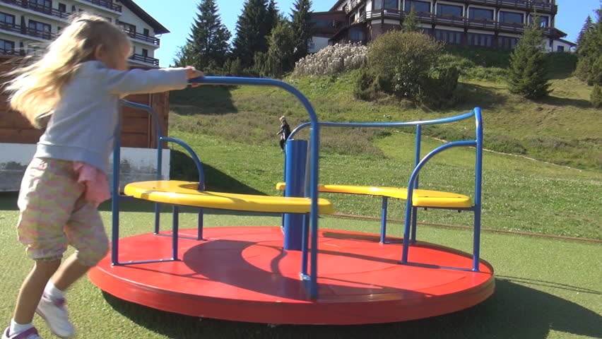 Child Playing Running At Playground Spinning Little Girl Kid Rotating On A Merry Go Round Children Stock Footage Video 5457182