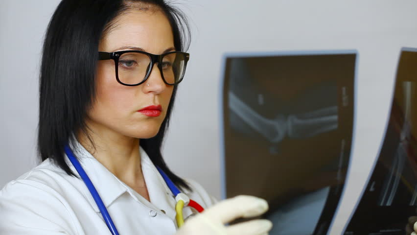 Female doctor  holding x-ray episode 1 | Shutterstock HD Video #5460932