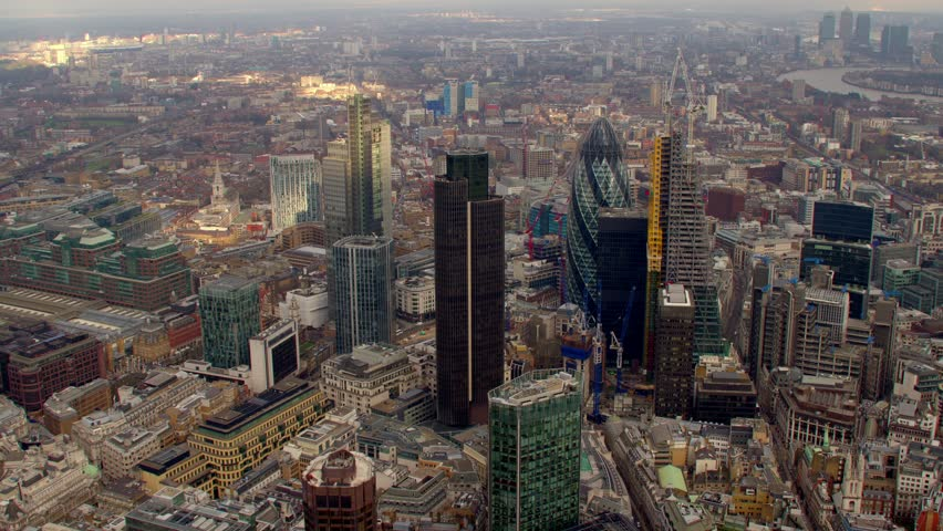 Aerial shot of Central London with view of the River Thames, The City Financial District, Liverpool Street & The Gherkin. Canary Wharf in the background.