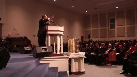 Memphis, TN - Circa 2013 - Pastor of an African/American church preaches to his congregation in Memphis, TN