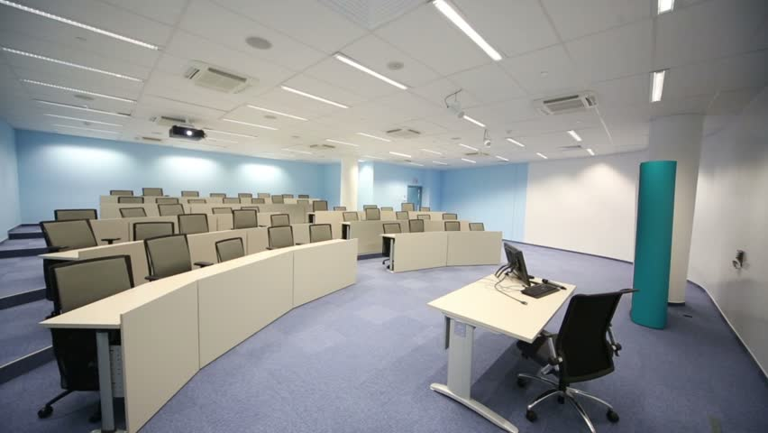 Empty small classroom with desks, chairs, projector and blue walls | Shutterstock HD Video #5471942