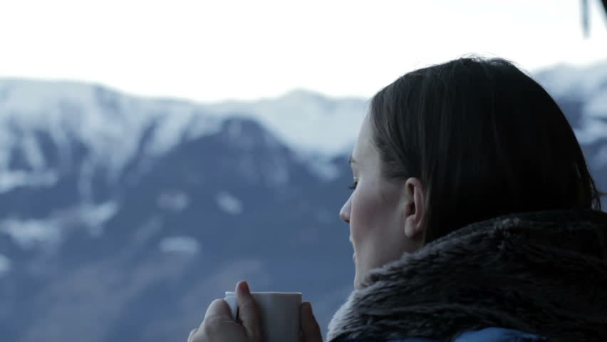 Beautiful girl drinking hot tea in the mountains, close up | Shutterstock HD Video #5474432
