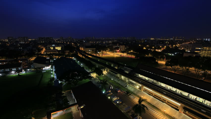 Time Lapse of Singapore MRT Subway and Fast Moving Vehicles in Eunos Housing Estate at Sunrise with Blue Hour 1080p