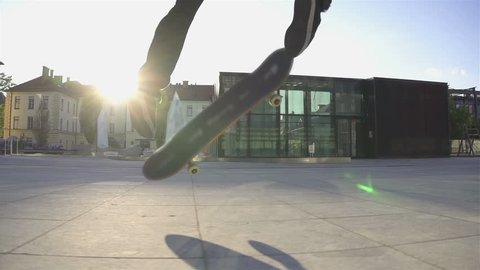 Skateboarder does flip at sunset